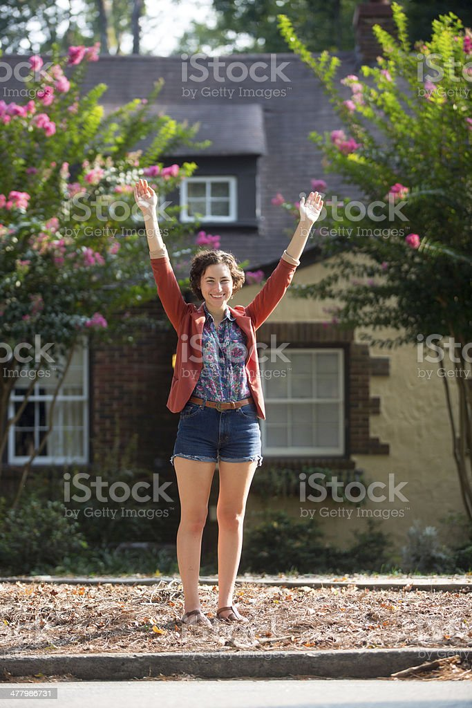 Portrait of Happy Young Woman with House royalty-free stock photo