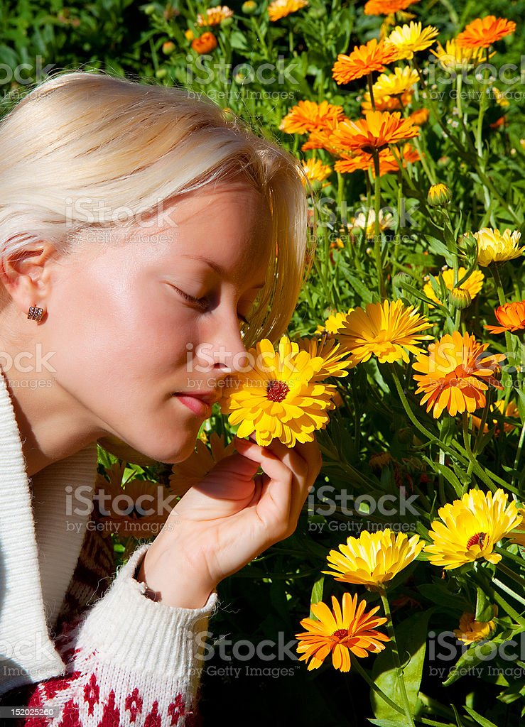 Portrait of happy young woman with marigold royalty-free stock photo