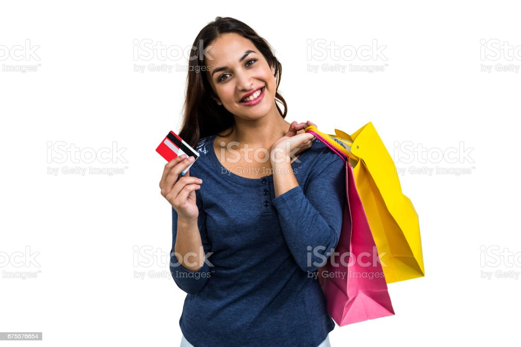 Portrait of happy young woman with shopping bags and payment card foto de stock royalty-free