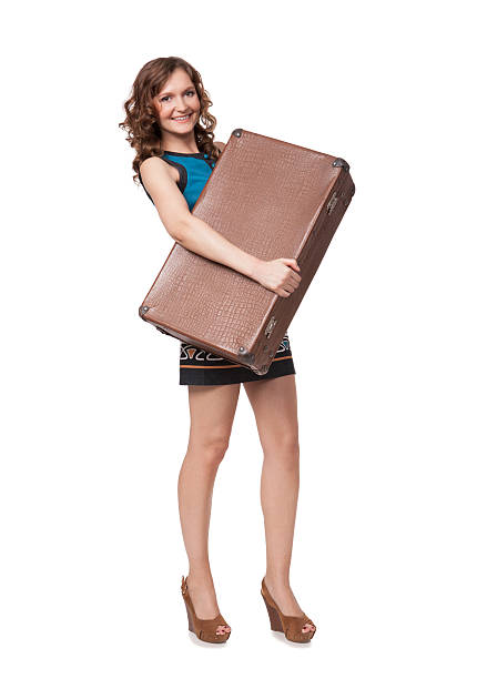 Portrait of happy young woman with suitcase stock photo