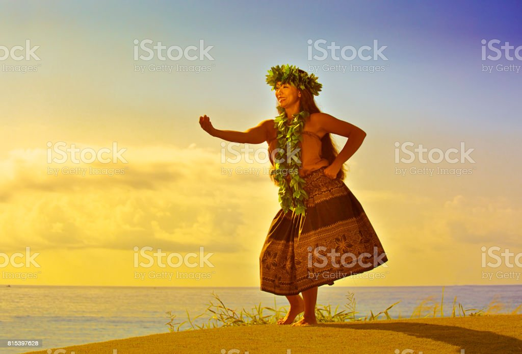 Portrait of Hawaiian Hula Dancer on the Beach at Sunset stock photo