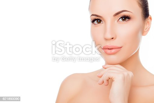istock Portrait of healthy beautiful woman in spa salon touching chin 621893090