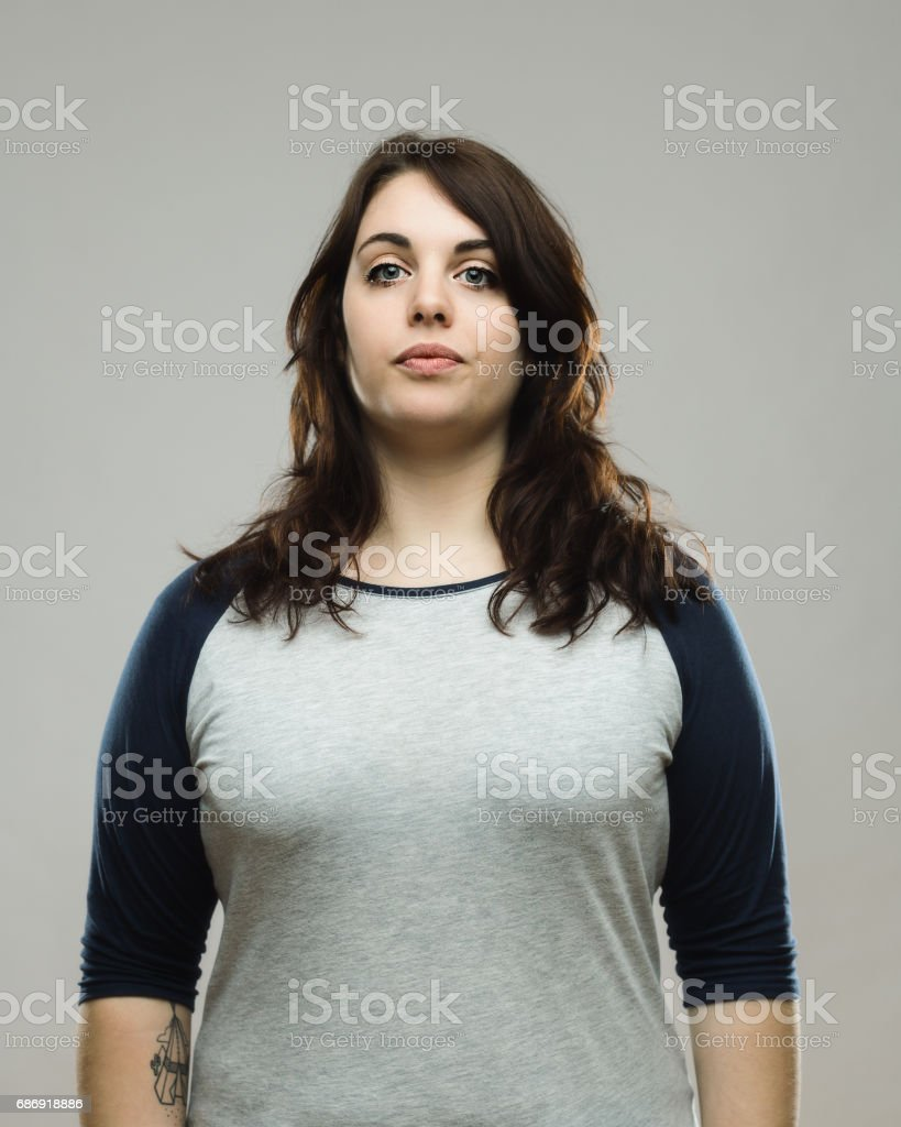 Portrait of healthy young woman on gray background stock photo