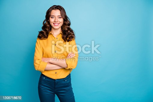 Portrait of her she nice attractive lovely cheerful cheery wavy-haired girl folded arms spring time isolated over bright vivid shine, vibrant green blue turquoise color background