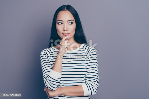 Portrait of her she nice attractive lovely wondered straight-haired lady wearing striped pullover sweater thinking looking aside touching chin isolated over gray pastel background