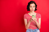 istock Portrait of her she nice attractive pretty lovely worried afraid wavy-haired teen girl free time using wi-fi scary news copy space isolated over bright vivid shine red background 1165694444