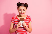 istock Portrait of her she nice cute charming attractive lovely winsome cheerful hungry girl wearing striped t-shirt holding in hands favorite desirable fresh dessert isolated over pink pastel background 1137022363