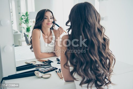 Portrait of her she nice sweet tender gentle attractive lovely stunning fascinating charming cute feminine cheerful well-groomed wavy-haired lady preparing in light white interior room.