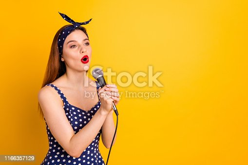Portrait of her she nice-looking attractive lovely cheerful cheery straight-haired,girl artist singing popular melody soul jazz isolated on bright vivid shine yellow background