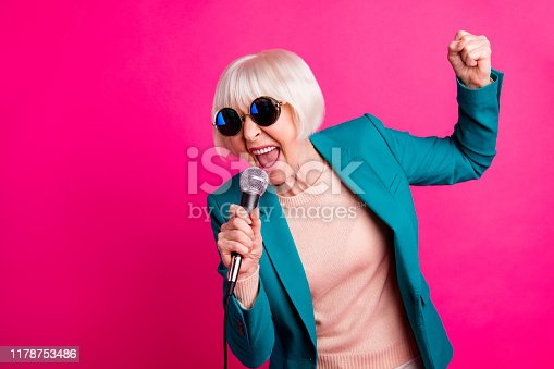 Portrait of her she nice-looking attractive lovely cheerful gray-haired lady, singing cool hit spending weekend isolated on bright vivid shine vibrant pink fuchsia color background