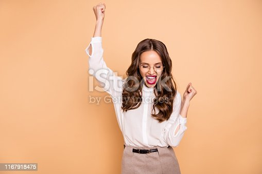 Portrait of her she nice-looking attractive lovely pretty gorgeous glamorous cheerful, cheery content wavy-haired lady celebrating great success having fun isolated over beige pastel background