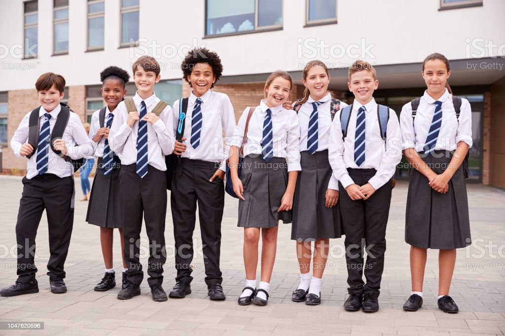 Portrait Of High School Student Group Wearing Uniform Standing Outside School Buildings stock photo