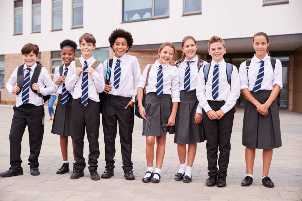Portrait Of High School Student Group Wearing Uniform Standing Outside School Buildings stock photo