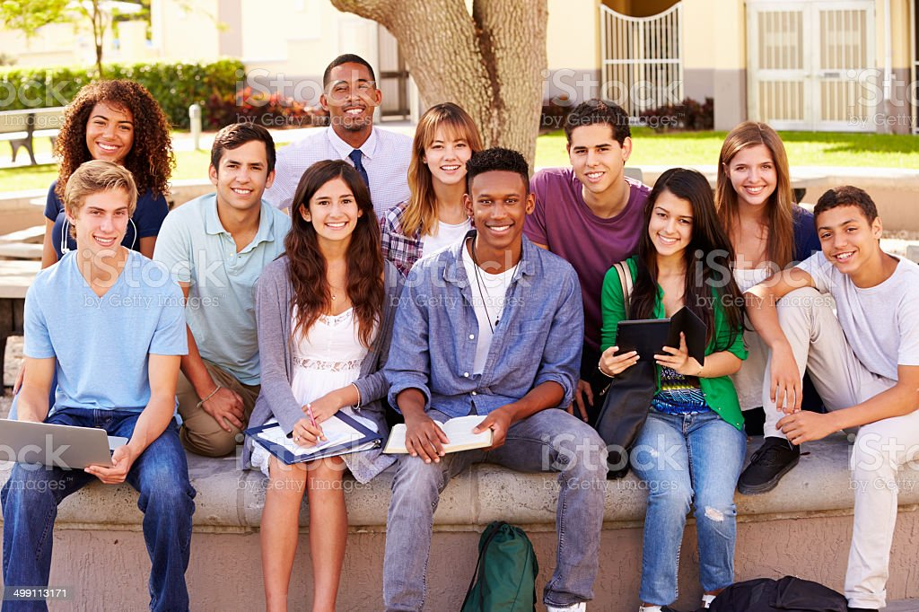 Portrait Of High School Students With Teacher On Campus stock photo