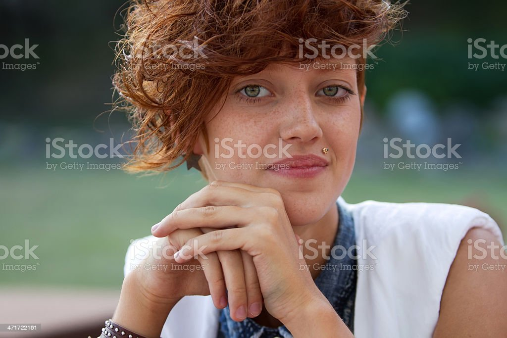 Portrait of hipster girl with lip ring stock photo
