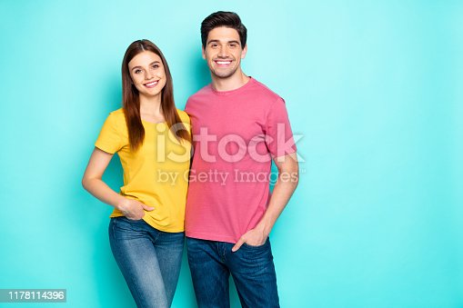 Portrait of his he her she nice attractive lovely sweet charming cute cheerful cheery couple hugging spending spring isolated over bright vivid shine vibrant green turquoise background