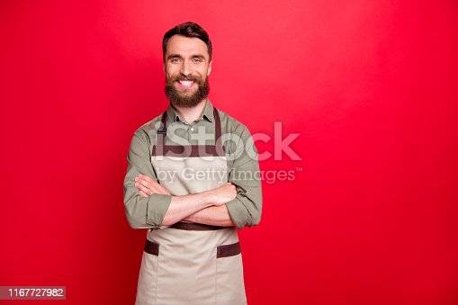 1165538246 istock photo Portrait of his he nice attractive cheerful cheery content bearded guy restaurant fast food owner folded arms isolated over bright vivid shine red background 1167727982