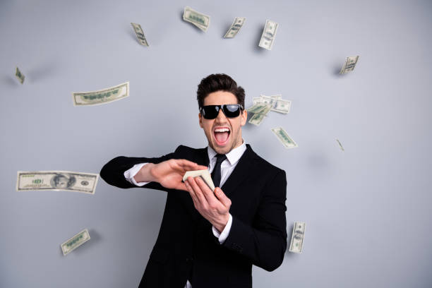 portrait of his he nice attractive cheerful guy professional executive leader expert development agent broker financier banker throwing away exchange lottery credit isolated over light gray background - throw money away stock pictures, royalty-free photos & images