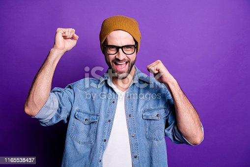 1165538246 istock photo Portrait of his he nice attractive confident cheerful cheery optimistic glad bearded guy celebrating great luck isolated over bright vivid shine violet lilac background 1165538437