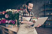 istock Portrait of his he nice attractive content cheerful cheery positive guy enjoying life lifestyle browsing surfing web wearing uniform at modern industrial loft concrete style 1158184835