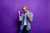 istock Portrait of his he nice attractive content cheerful cheery satisfied bearded guy celebrating good luck lottery winning isolated over bright vivid shine violet lilac purple background 1165538388