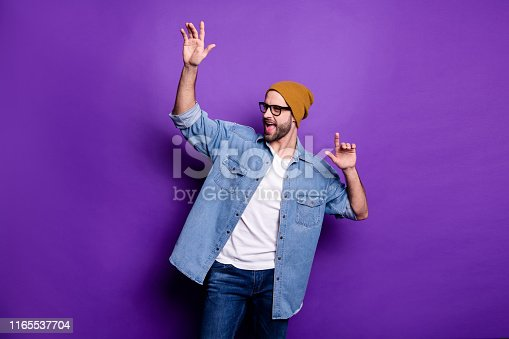 1165538246 istock photo Portrait of his he nice attractive content cool cheerful cheery carefree bearded guy celebrating great festal party having fun isolated over bright vivid shine violet lilac background 1165537704