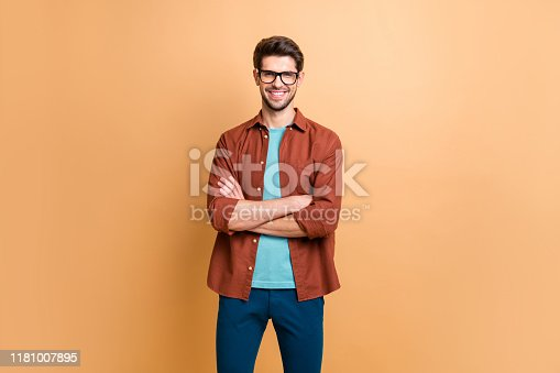 istock Portrait of his he nice attractive content successful cheerful cheery brunet guy company director owner folded arms isolated over beige color pastel background 1181007895