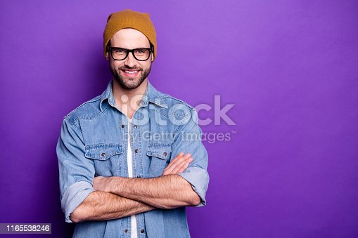istock Portrait of his he nice attractive content virile cheerful cheery bearded guy folded arms copy space cool lifestyle isolated over bright vivid shine violet lilac purple background 1165538246