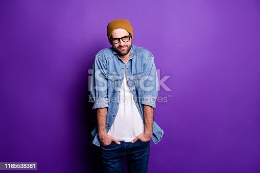 1165538246 istock photo Portrait of his he nice attractive discontent bearded guy holding hands in pockets avoiding ignoring participation isolated over bright vivid shine violet lilac purple background 1165538381