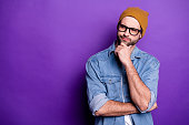 Portrait of his he nice attractive doubtful bearded guy touching chin thinking, guessing strategy copy space isolated over bright vivid shine violet lilac purple background