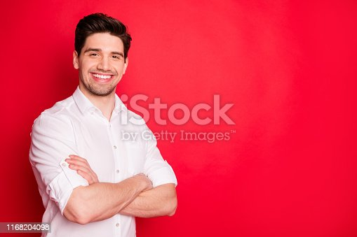 1165538246 istock photo Portrait of his he nice attractive lovely cheerful cheery glad content guy representative executive director copy space isolated over bright vivid shine red background 1168204098