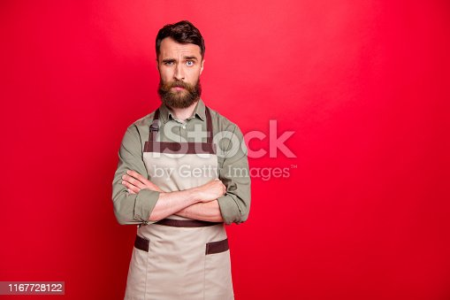 istock Portrait of his he nice attractive puzzled disappointed confused ignorant bearded guy small garage studio factory owner folded arms isolated over bright vivid shine red background 1167728122