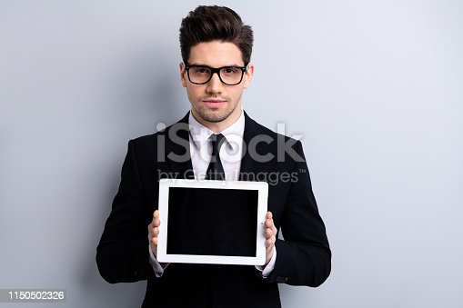 Portrait of his he nice classy attractive guy demonstrating holding in hands black display digital technology recommend executive leader expert development isolated over light gray background.
