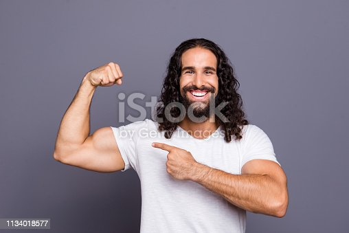 istock Portrait of his he nice cool groomed attractive cheerful cheery glad wavy-haired guy pointing finger at trained sportive muscle proud isolated over gray violet purple pastel background 1134018577