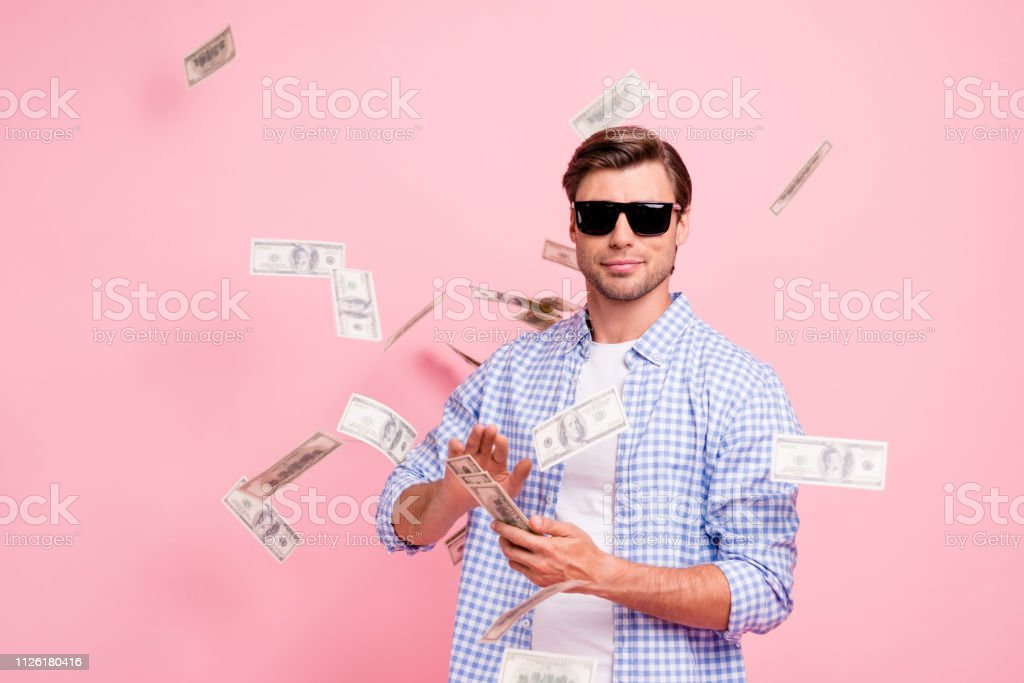 Portrait of his he nice cool trendy content attractive handsome candid guy wearing checked shirt throwing money flying in air party wealth isolated over pink pastel background Portrait of his he nice cool trendy content attractive handsome candid guy wearing checked shirt throwing money flying in air party wealth isolated over pink pastel background Adult Stock Photo