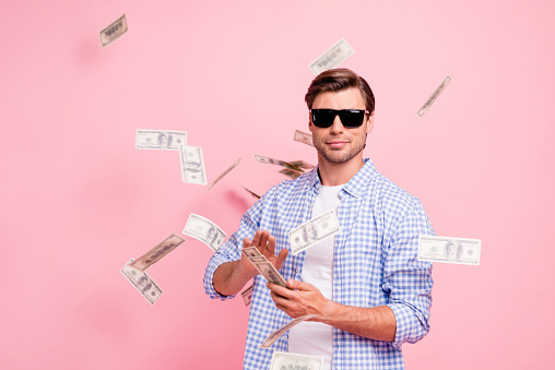 Portrait Of His He Nice Cool Trendy Content Attractive Handsome Candid Guy Wearing Checked Shirt Throwing Money Flying In Air Party Wealth Isolated Over Pink Pastel Background Stock Photo - Download Image Now