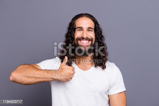 1092211952 istock photo Portrait of his he nice cool well-groomed attractive cheerful cheery wavy-haired guy showing thumbup ad advert choose isolated over gray violet purple pastel background 1134020717