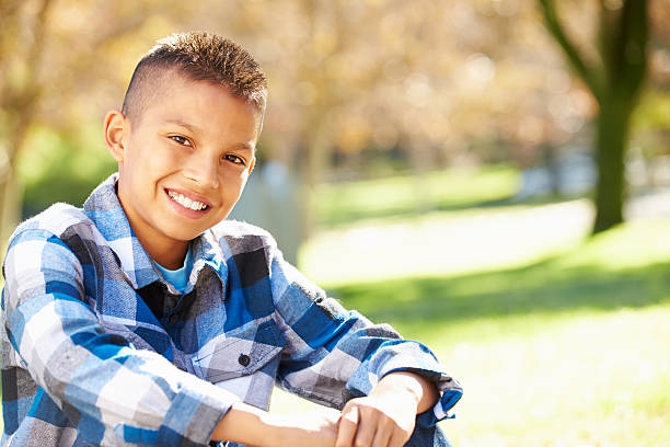 Portrait Of Hispanic Boy In Countryside Portrait Of Hispanic Boy In Countryside Smiling To Camera 12 13 years stock pictures, royalty-free photos & images