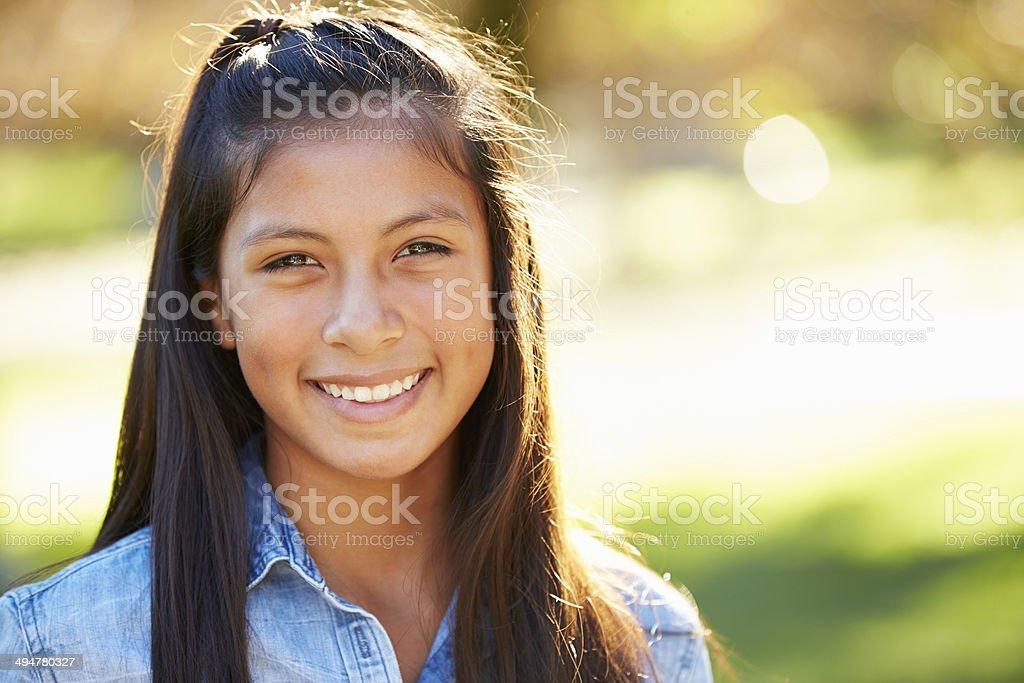 Portrait Of Hispanic Girl In Countryside stock photo