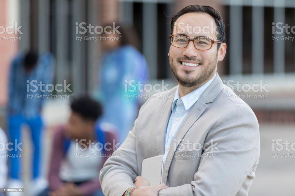 Portrait of Hispanic male high schools teacher stock photo