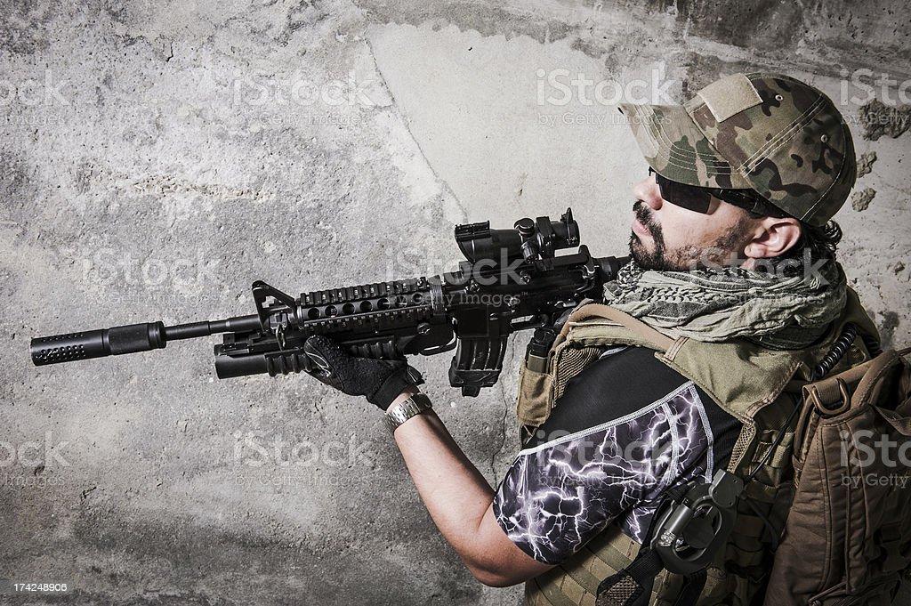 Portrait of Hispanic Modern Mercenary Soldier Holding Rifle stock photo