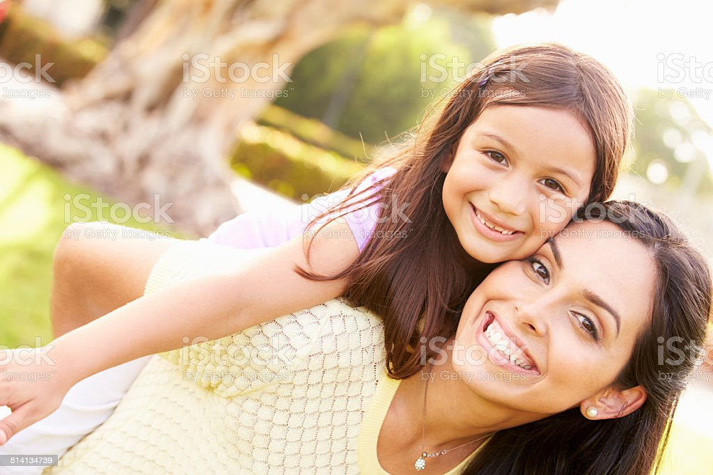 Portrait Of Hispanic Mother And Daughter In Park royalty-free stock photo