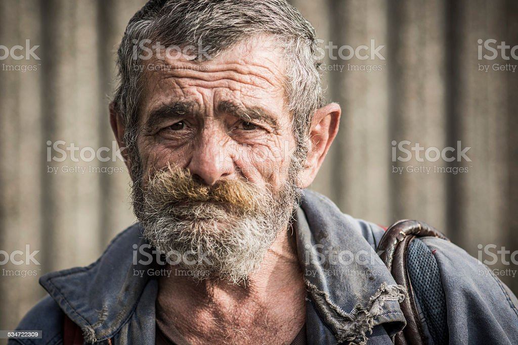 Portrait of homeless man stock photo