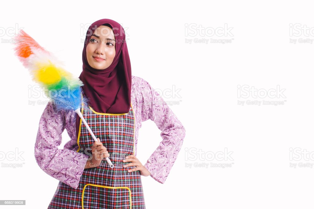 Portrait of housewife wearing an apron and hold a cleaning tool isolated on white background - cleaning concept stock photo