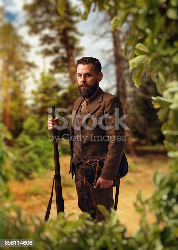 658114236 istock photo Portrait of hunter in traditional hunting clothing 658114606