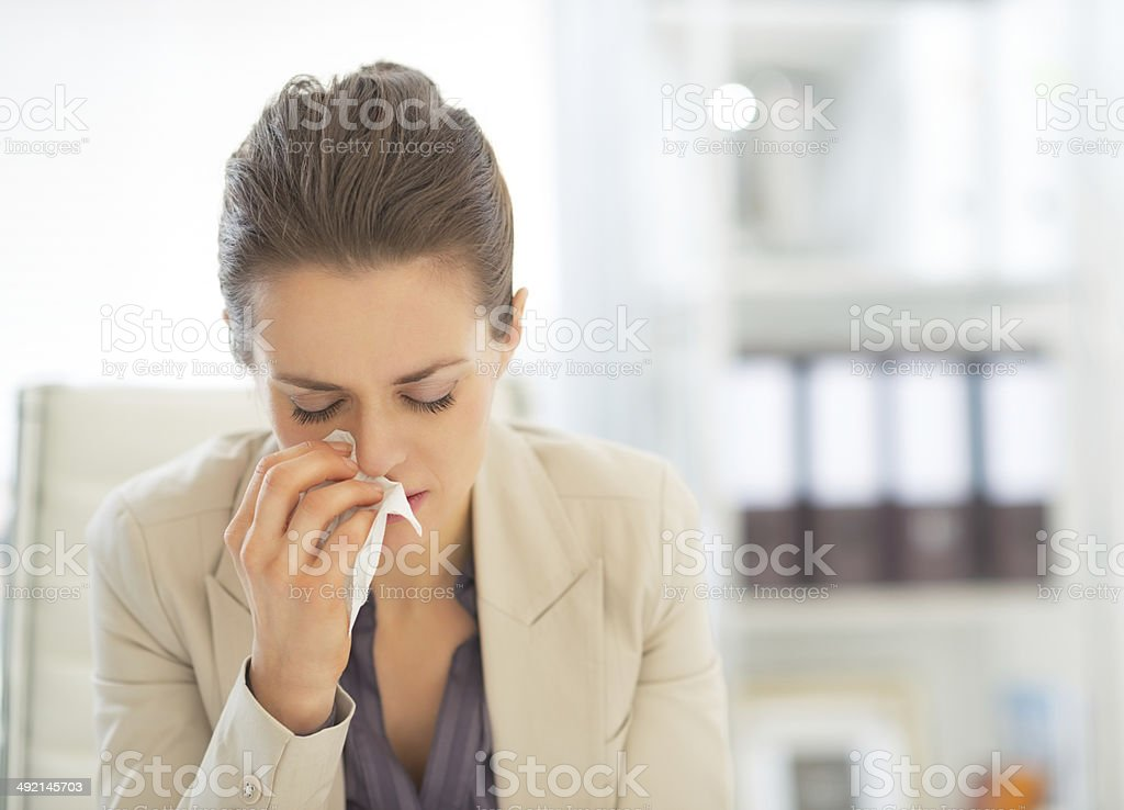 portrait of ill business woman at work stock photo