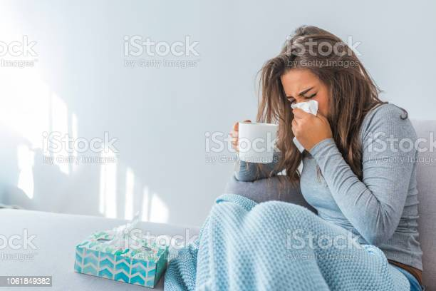 Photo of Portrait Of Ill Woman Caught Cold
