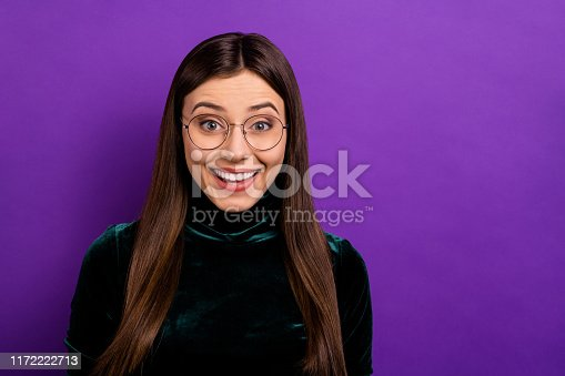 Portrait of impressed lady looking shouting wearing black turtleneck isolated over purple violet background