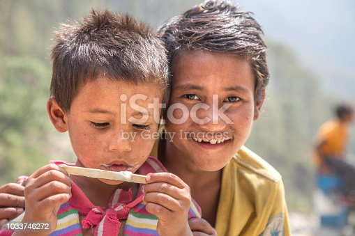 941788480 istock photo Portrait of Indian Little Boy with Ice Cream 1033746272