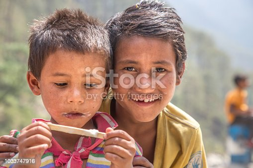 941788480 istock photo Portrait of Indian Little Boy with Ice Cream 1033747916